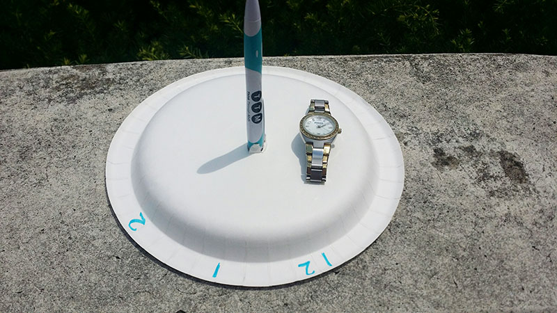 DIY sundial with watch for making guesses